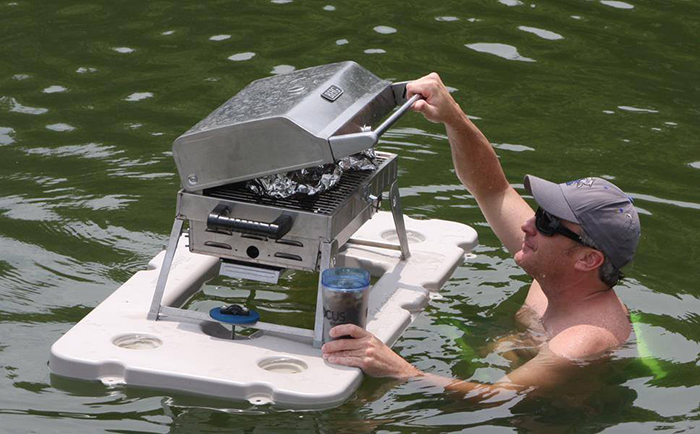 man opening a bbq grill on floating bar