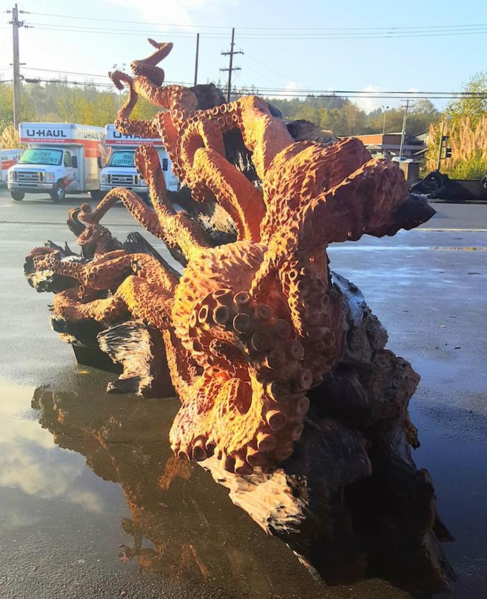 massive sea creature wooden sculpture work in progress
