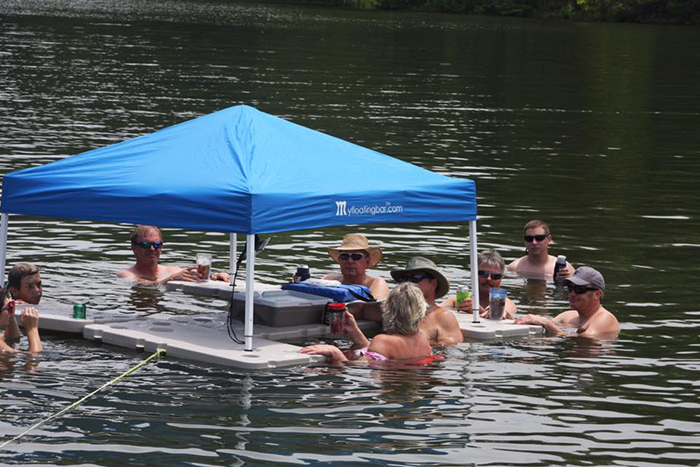 people gathered around a floating bar