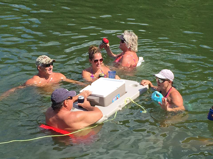 people in pool with connectable cooler float