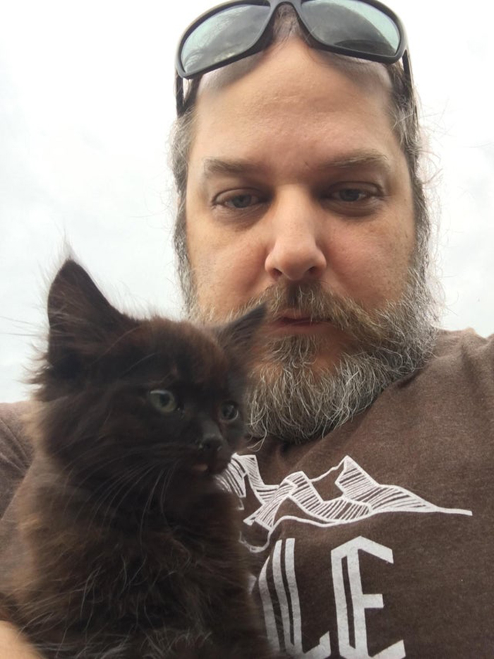 wholesome cat posts man and black cat