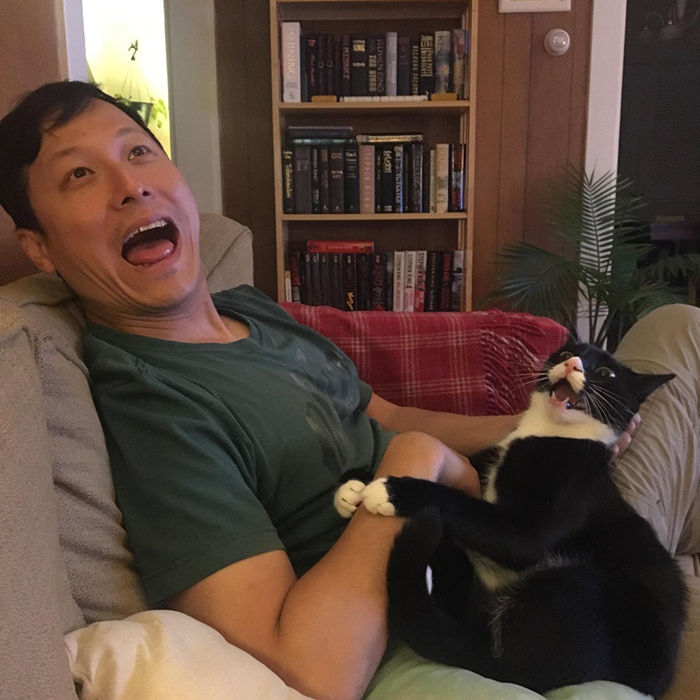 wholesome cat posts man and cat with same facial expression