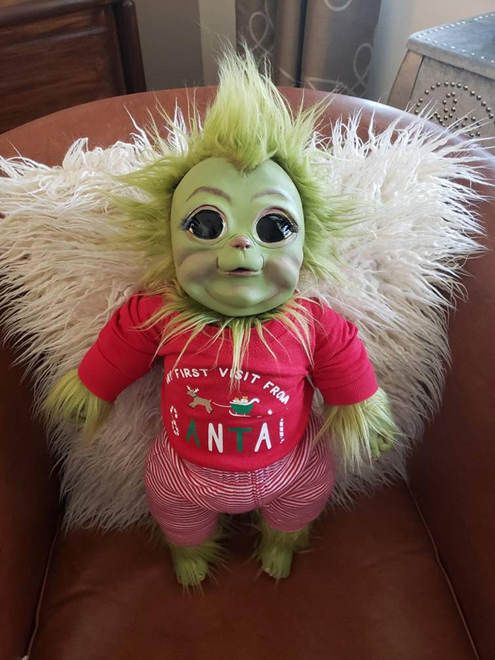 baby grinch doll in red shirt and striped pants