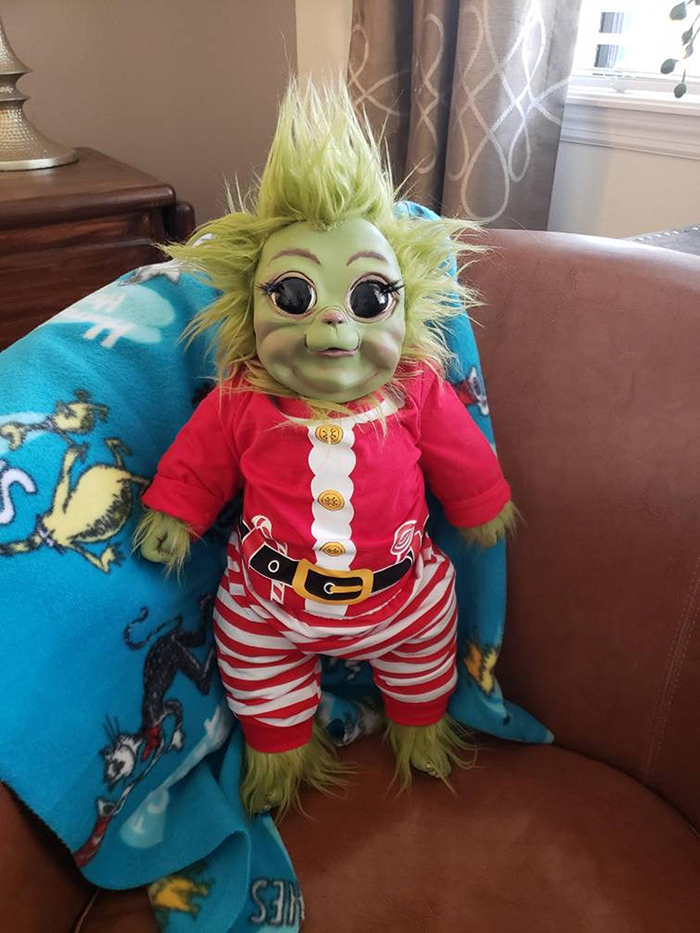baby grinch doll in santa claus costume