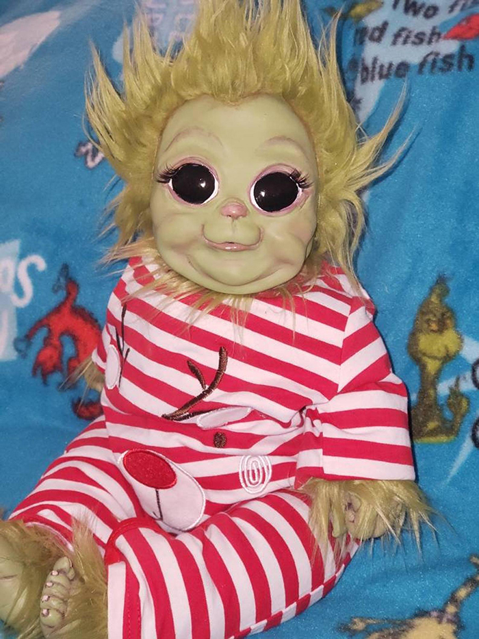 baby grinch doll in striped reindeer costume