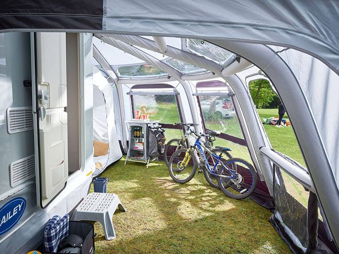 bicycles parked under an rv awning