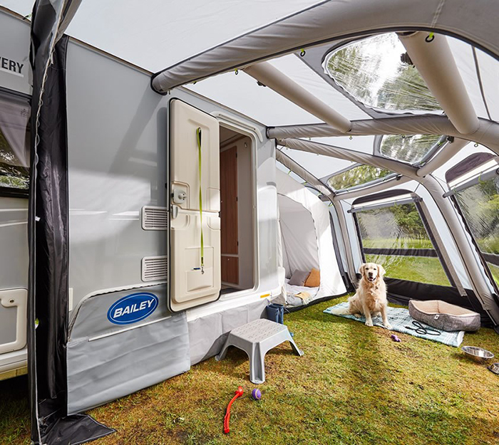 dog under an inflatable rv awning