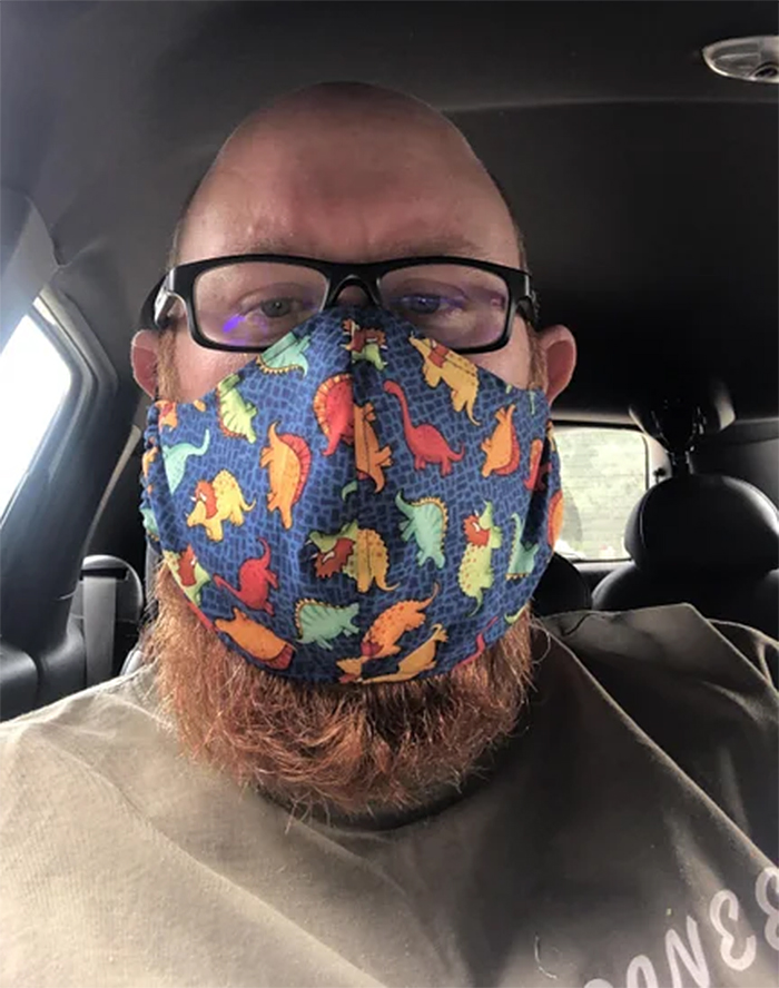 face mask with dinosaur pattern
