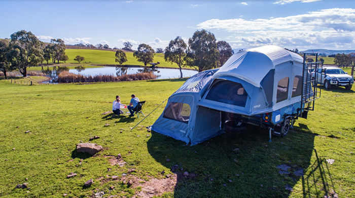 family camping by a pond