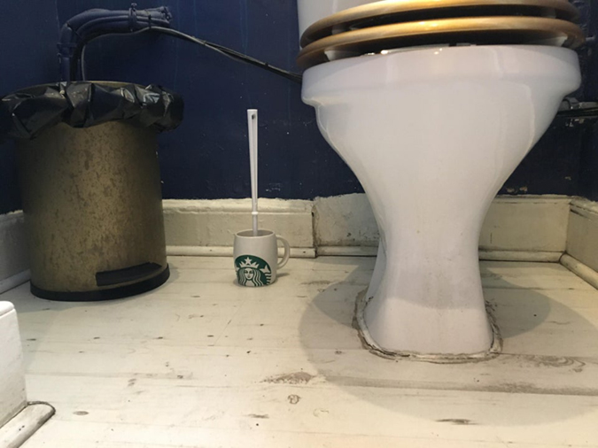 funny shops independent coffee shop uses starbucks mug as toilet brush holder