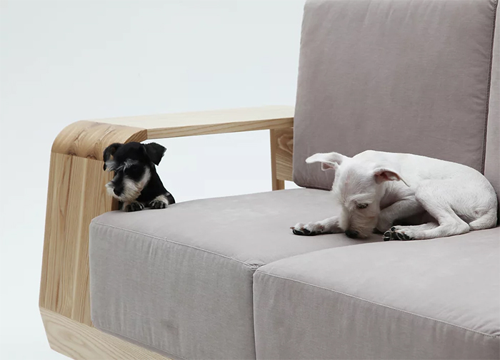 sofa with large wooden armrest pet house