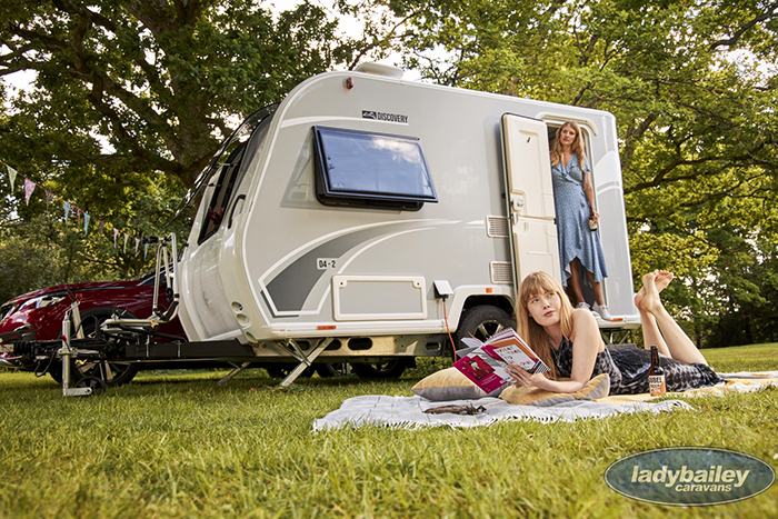 two ladies outdoor with a bailey discovery d4-2 camper trailer