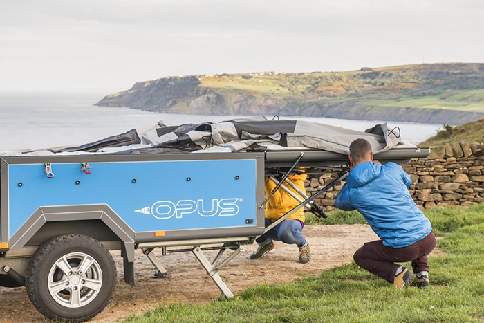 two persons setting up self-inflating trailer