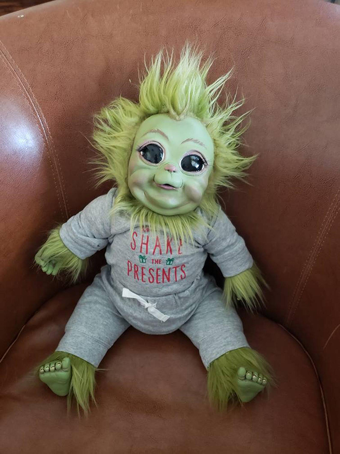 young grinch plush toy in grey costume