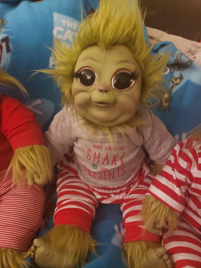young grinch plush toy in grey shirt and striped pants