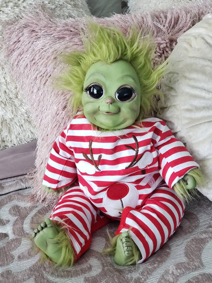 young grinch plush toy in striped reindeer costume