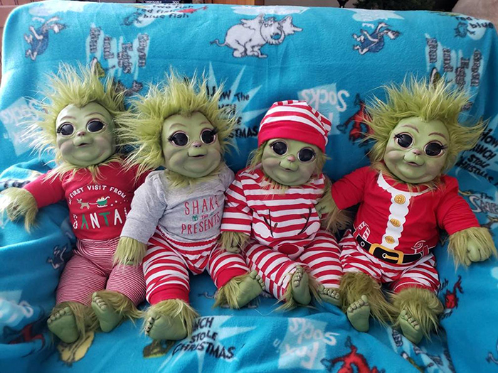 young grinch plush toys in christmas themed costumes