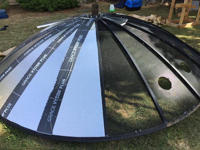 10-foot satellite dish half covered with styrofoam insulation