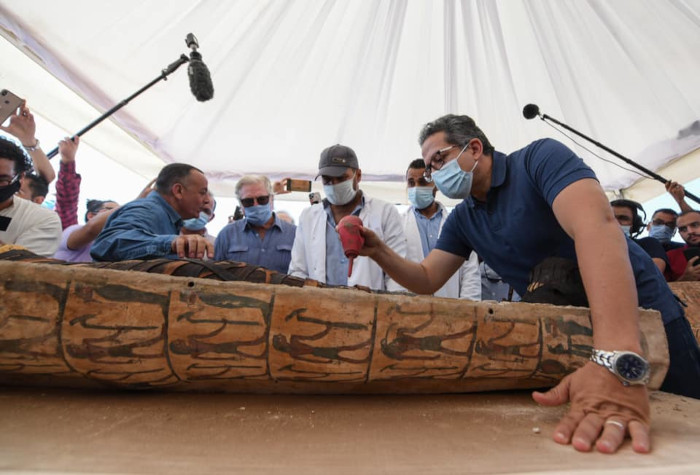 Dr Al-Anani cleans off dust from the mummy