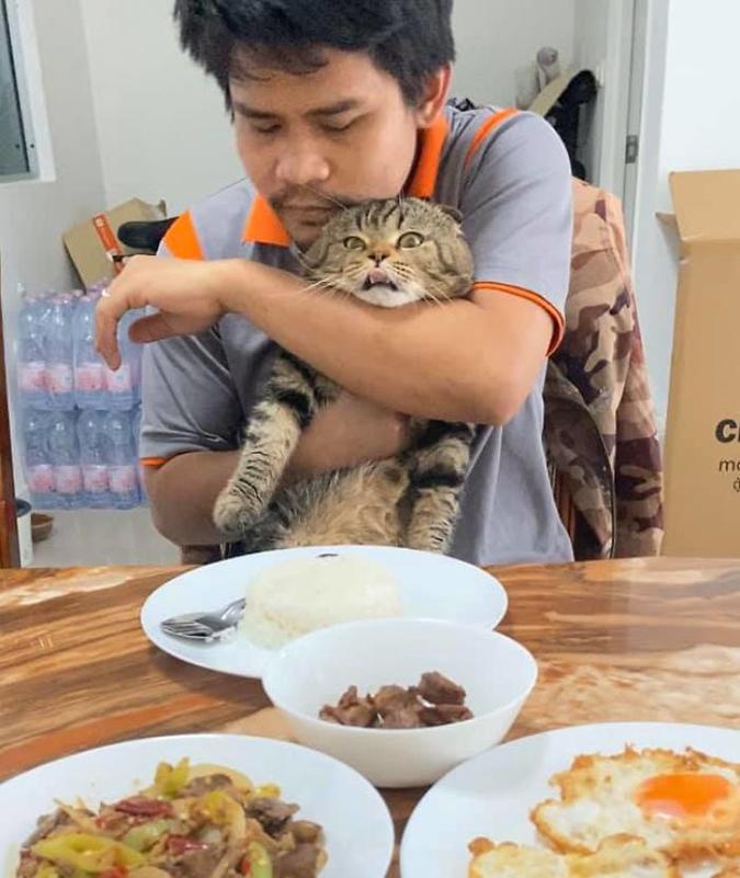 Fur-dad hugs Jarvis before his meal