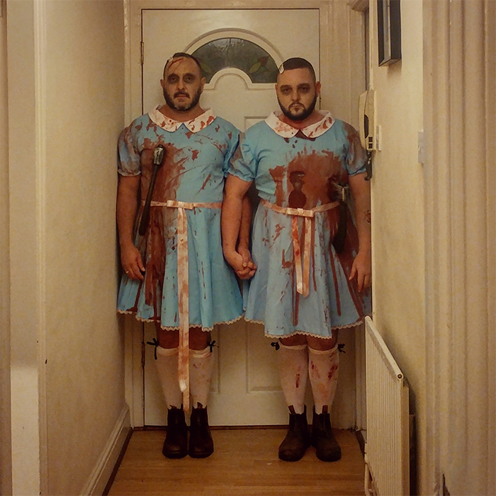 brothers dressed up as shining twins