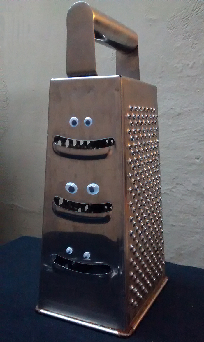 cheese grater with googly eyes