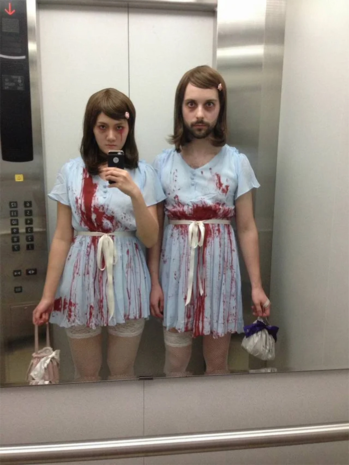couple dressed up as shining twins
