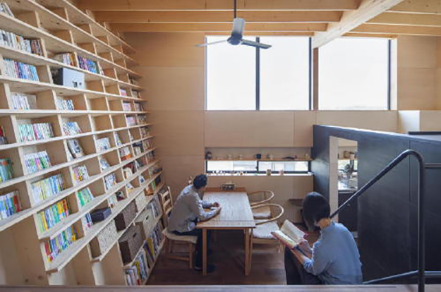 couple reads next to their earthquake-proof bookshelf