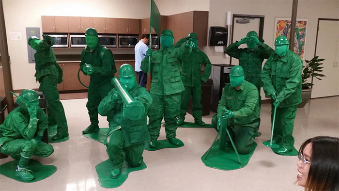 guys dressed up as tiny toy soldiers