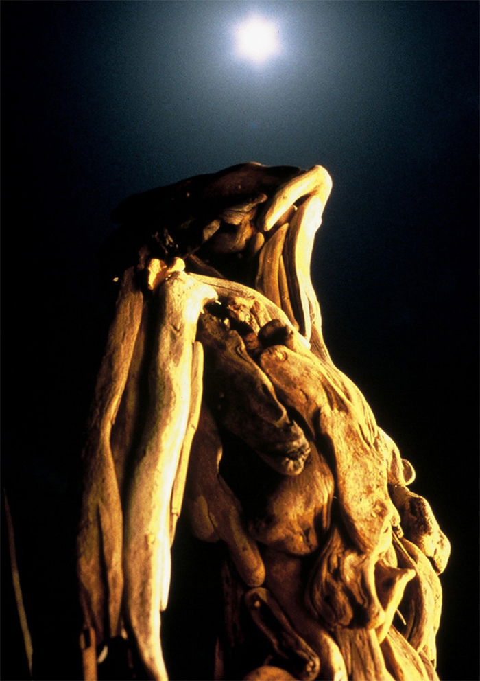 haunting wooden statues