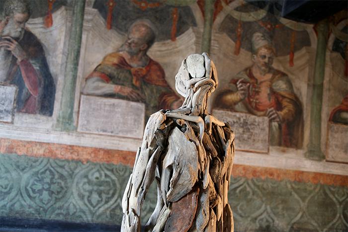 human-like wooden figures art gallery