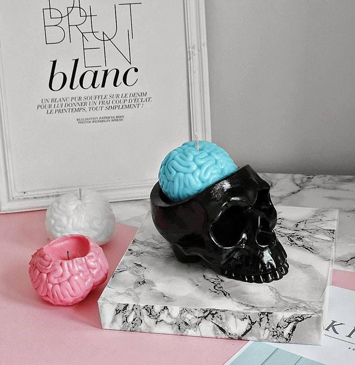 pastel-colored human brain candles and black skull holder