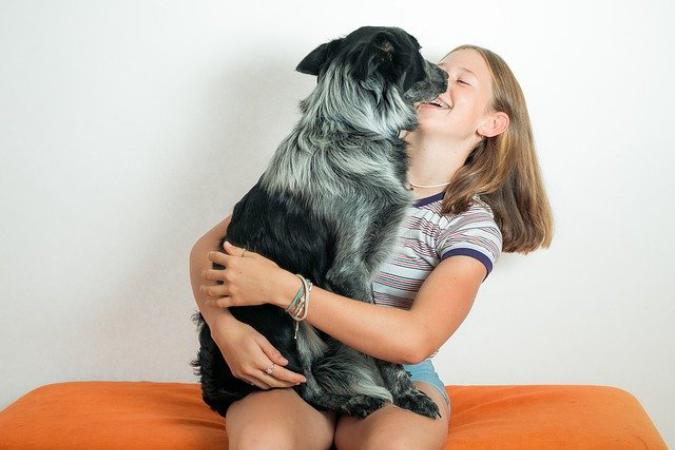 pixabay-girl-cuddles-with-dog