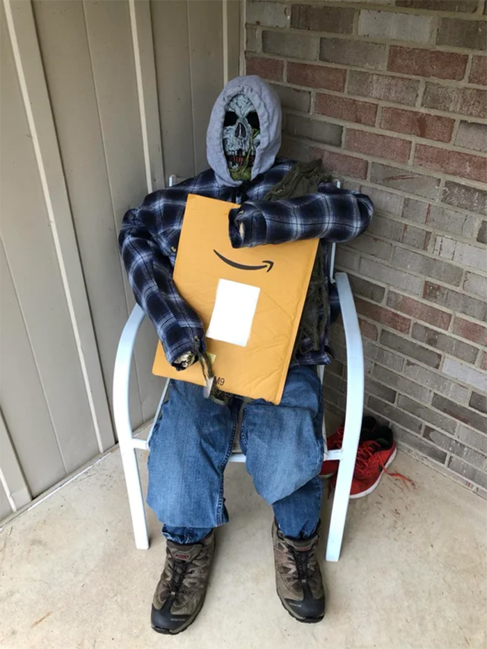 spooky figure holding a package