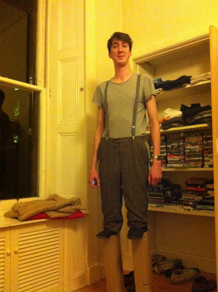 tall guy hilarious outfit short man on stilts