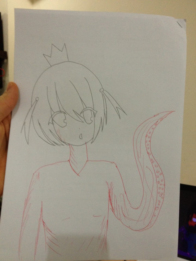 teacher doodles a body and tentacle arm to complete student's drawing