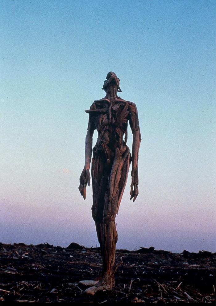 uncanny wooden human figures