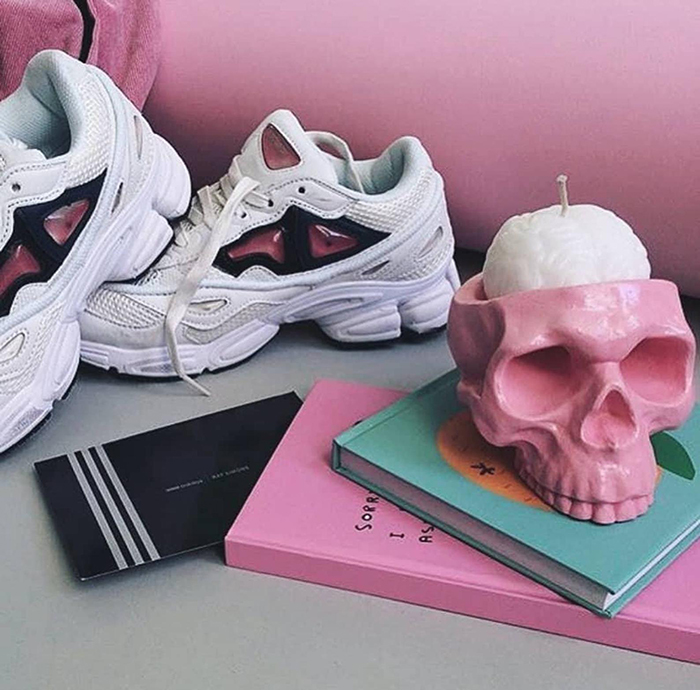 white human brain candle in pink skull holder