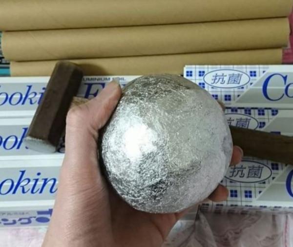 aluminum foil balls flatted by ball-peen hammer