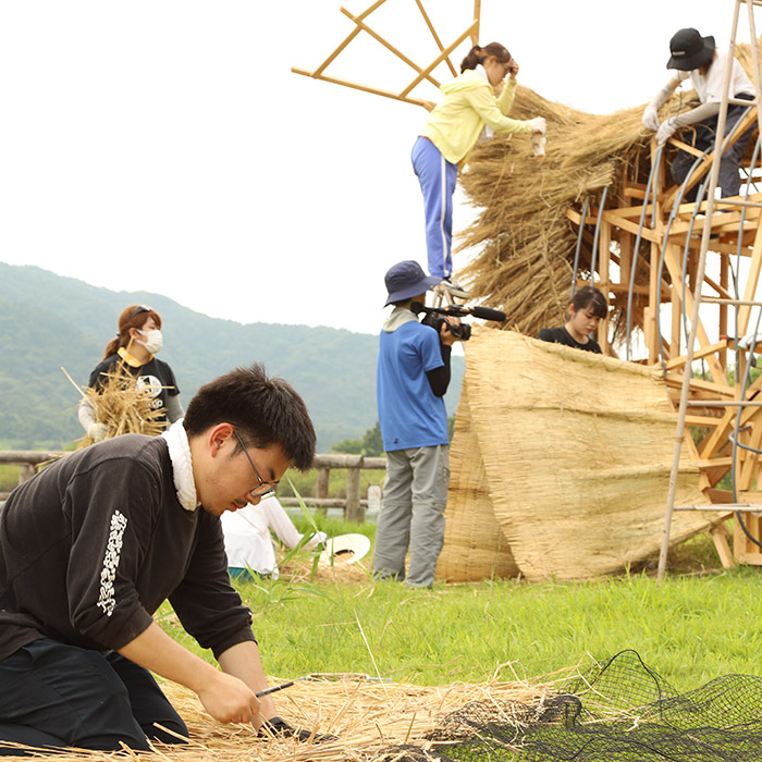 art students create sculptures using rice straw