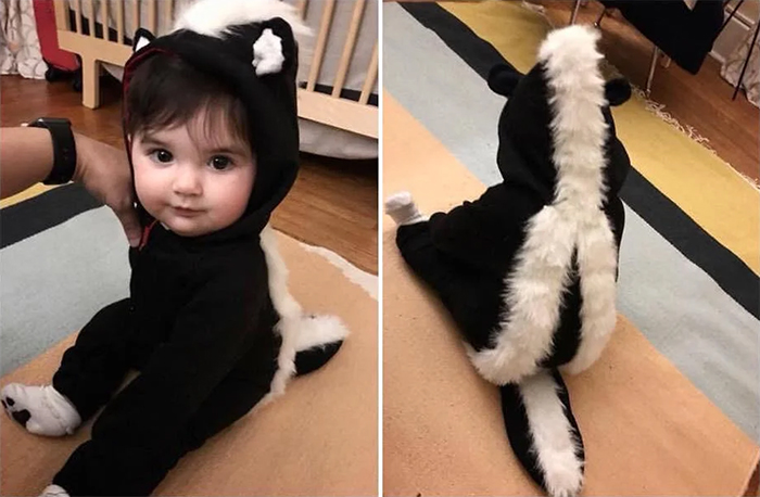 baby in skunk outfit