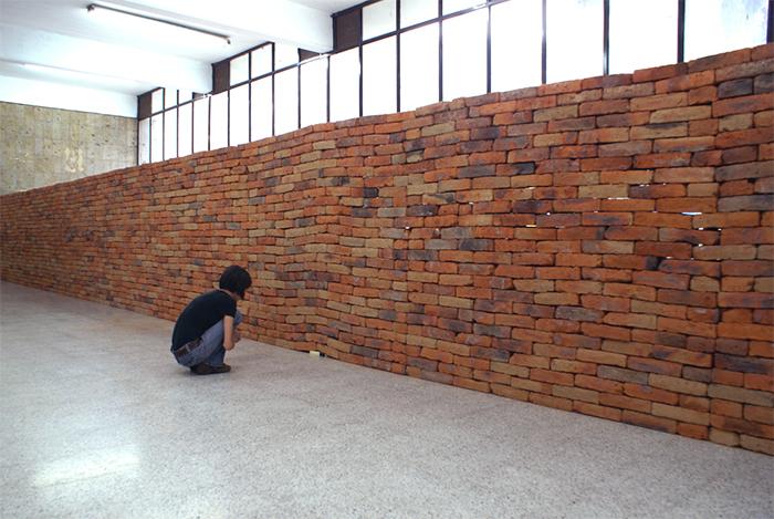 brick wall book installation art