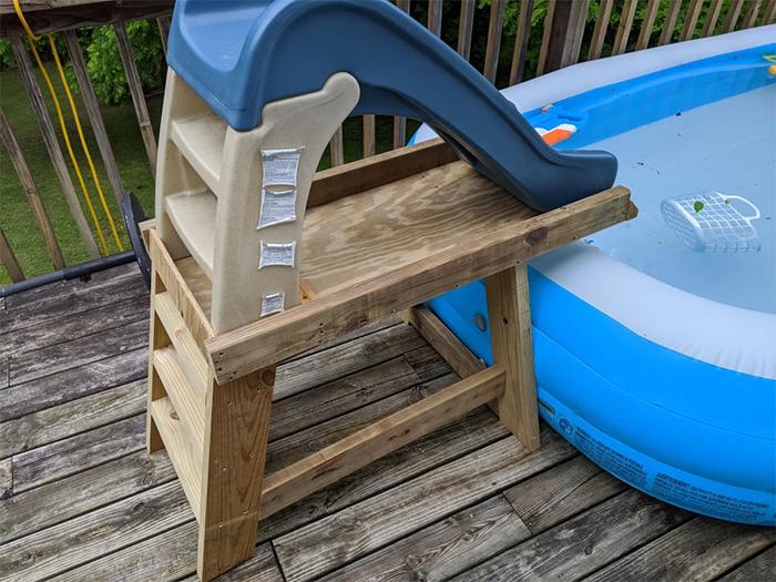 creative father creates slide for pool