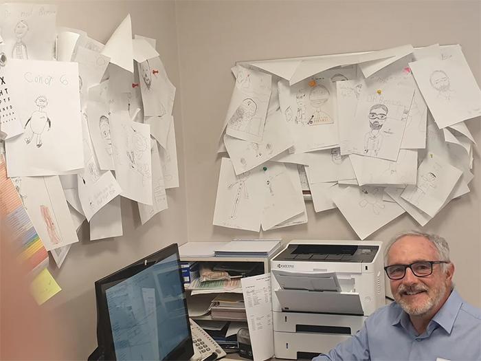 doctor keeps kids drawings of him