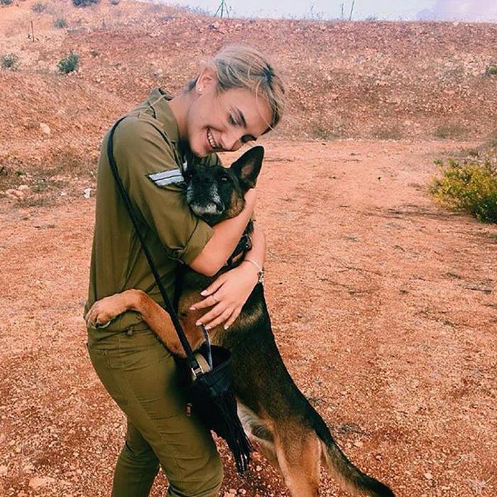 lady hugging a german shepherd