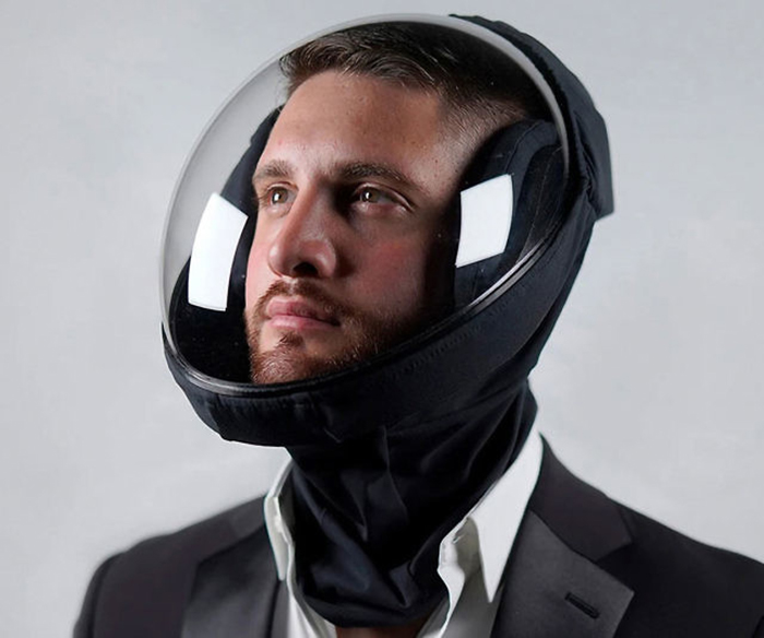 man wearing a black ventilating helmet