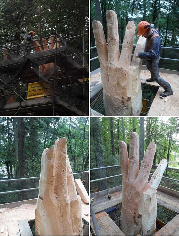 sculptor turns damaged tree into hand sculpture
