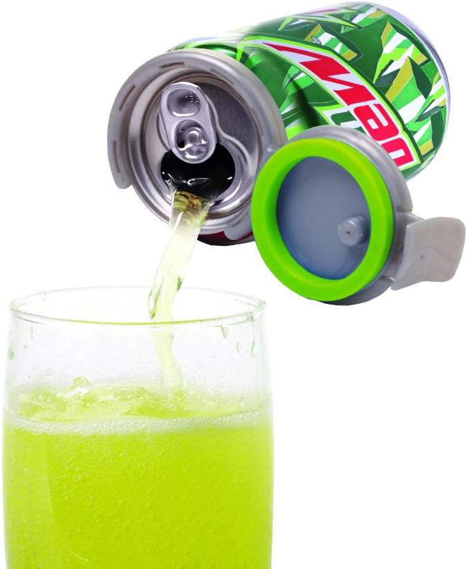 soda being poured while the mountain dew can pump and fizz keeper is open