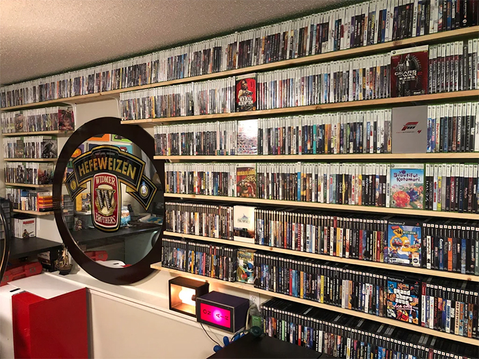 wife builds shelves for husband game collection