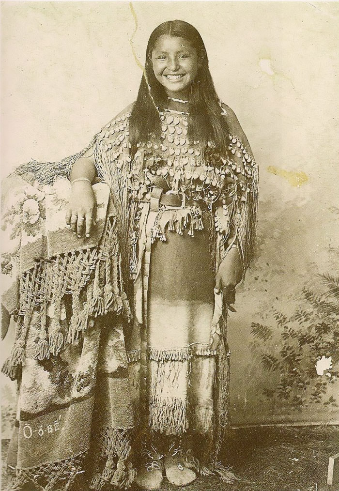 1894 photo of native american woman smiling